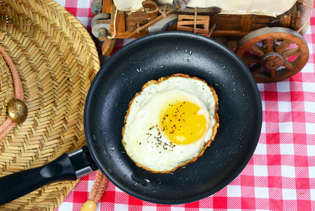 sunny side: Old style country egg breakfast with egg sunny side up. Stock Photo