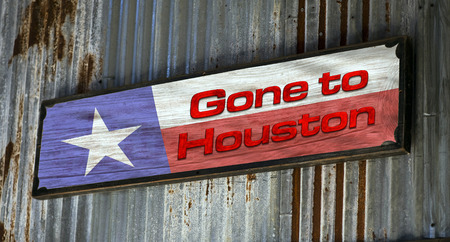gone: Gone to Houston sign on old side of barn.