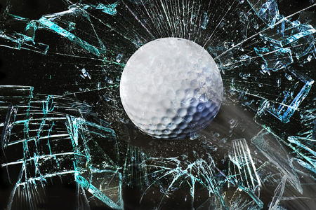 destroying the competition: Fast golf ball through broken window.