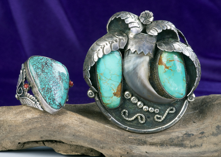 curve claw: Old Navajo Royston turquoise bear claw cuff and spiderweb turquoise Navajo ring. Stock Photo