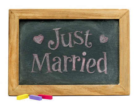 Just married sign on black chalkboard.