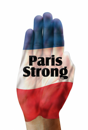 counter terrorism: Paris strong with French flag on hand..