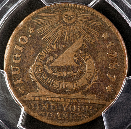 copper coin: Fugio copper coin was the first coin to be issued by the New United States in 1787. Many historions say that Benjamin Franklin helped to design this first American coin.