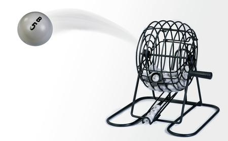 Bingo ball cage with winning flying numbers.