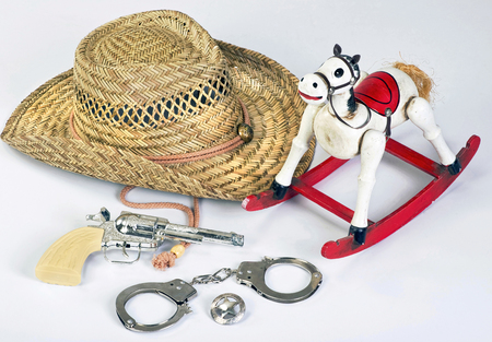 lawman: Old vintage childhood western cowboy toys. Stock Photo