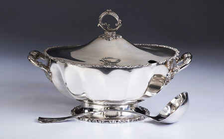 tureen: English silver soup tureen with silver ladle made in the 1800s.