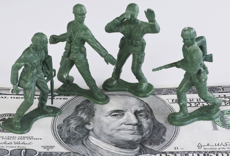 ben franklin money: Guarding American money with green toy soldiers.