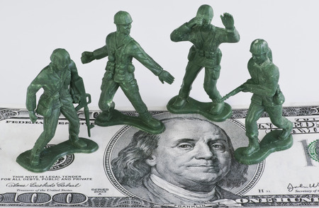 us soldier: Guarding American money with green toy soldiers.