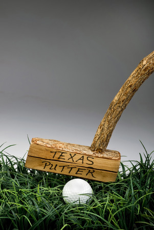 wacky: Texas golf putter straight off the old tree. Stock Photo