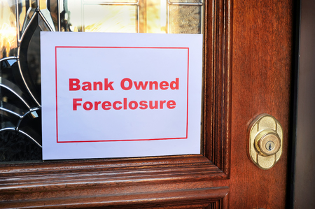 resale: Bank owned foreclosure sign on home. Stock Photo