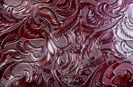 leather background: Carved and tooled leather background. Stock Photo