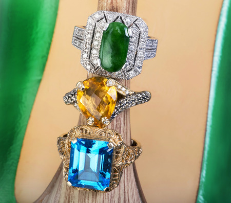 karat: Blue Topaz, yellow citrine and imperial green jade rings.
