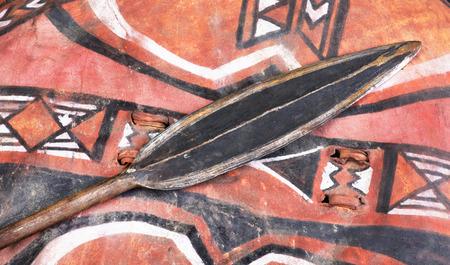 spear: African Maasai spear head on skin shield.