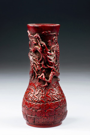 antique vase: Antique Chinese red cinnabar dragon vase made in the 19th century. Stock Photo