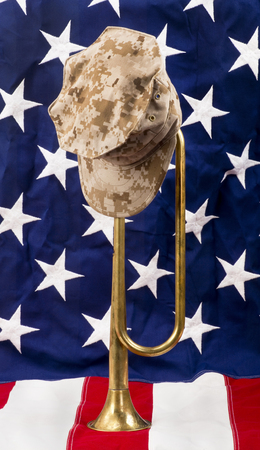 solders: Solders brass bugle on American flag.