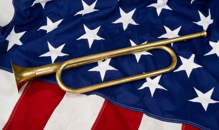 marine: Brass bugle on a American flag. Stock Photo