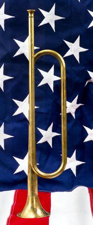 bugle: Brass bugle on a American flag. Stock Photo