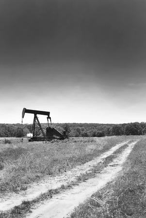 texas tea: Texas oil well pumper in black and white with room for your type.
