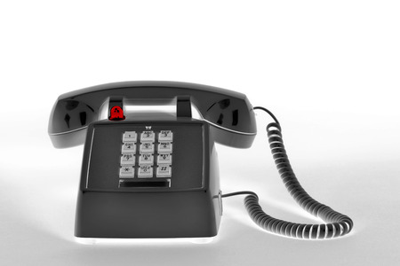 hangup: Old style telephone in reversed  black and white.