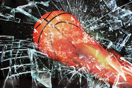 Basketball on fire through broken glass window. Stock Photo