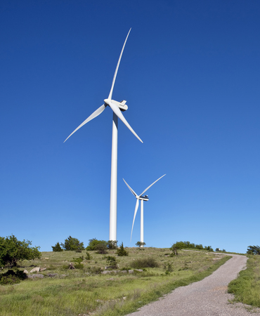 windfarm: Wind turbines in the hills of  Oklahoma with room for your type. Stock Photo
