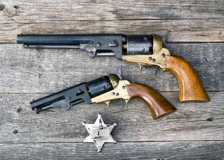 peacemaker: The guns that won the west and silver sheriff badge.