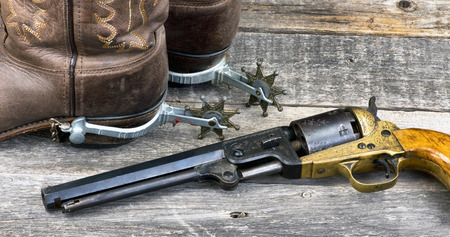 Old western pistol,spurs and cowboy boots. Stock Photo