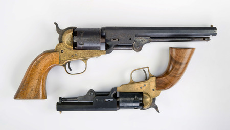 six shooter: Two old western six shooter cowboy pistols.