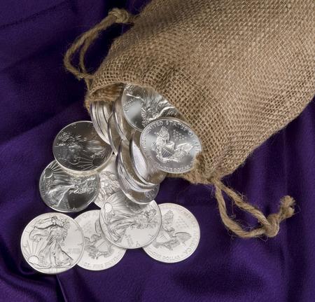 Burlap sack of silver eagle dollars.