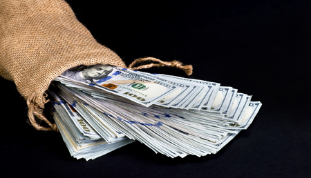 burlap bag: Bag of American cash in a burlap bag with room for your type. Stock Photo
