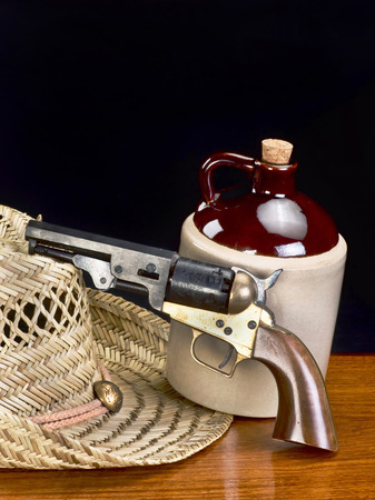 six shooter: Old western six shooter and jug of white lighting with room for your type.