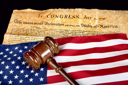 declaration: Declaration of Independence with American flag and wooden gavel.
