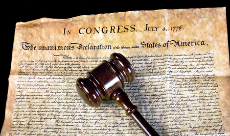 American Declaration of Independence and wooden gavel.