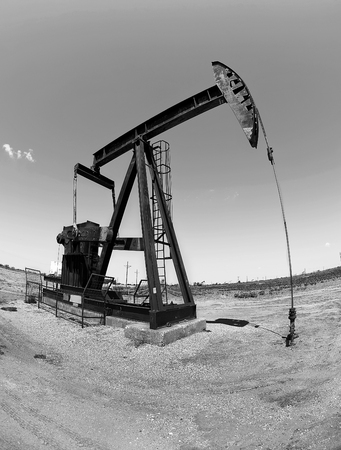 Oil well pumper in black and white with room for your type.. Stock Photo