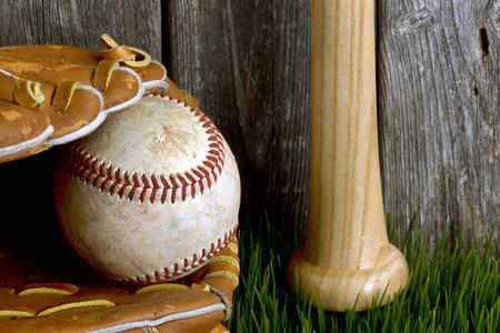hardball: Baseball ,bat and ball on green grass. Stock Photo