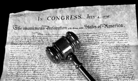 declaration: American Declaration of Independence and wooden gavel in black and white.