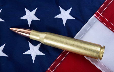 50 caliber brass bullet on American flag with room for your type..