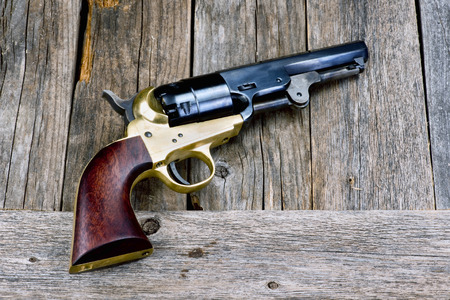 six shooter: Old western cowboy pistol with room for your type.