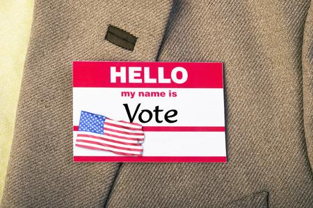 lapel: Vote badge on lapel of tweed jacket.