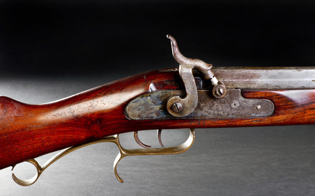 old rifle: Old black powder cap and ball double trigger rifle.