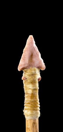 indian artifacts: Real American Indian bird point pink flint arrowhead with room for your type. Stock Photo