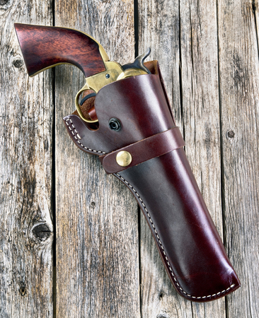 barrel bomb: American cowboy 45 pistol sometimes called a hogleg.