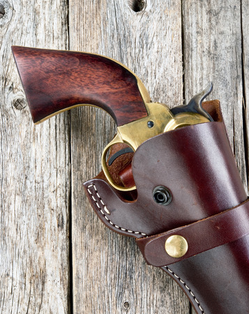 Old western pistol in leather holster.