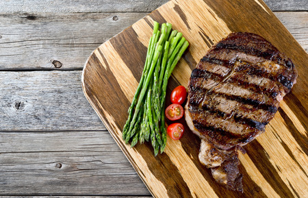 rib eye: Fresh grilled rib eye steak ready to eat with room for your type. Stock Photo