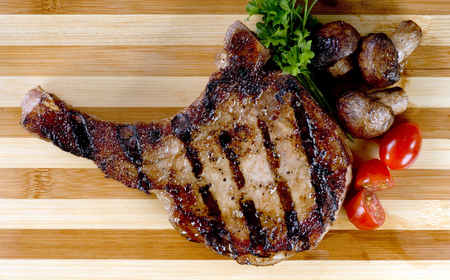 grilled pork chop: Fresh grilled  pork chop ready to eat. Stock Photo