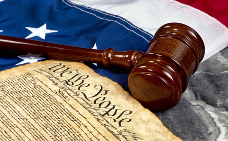 bill of rights: Wooden gavel on top of American flag and Bill of Rights document