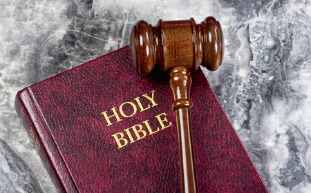 Wooden gavel on top of Bible with room for your type. Stock Photo