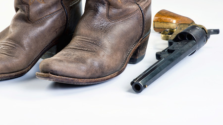 Old cowboy boots and old cowboy pistol with room for your type..