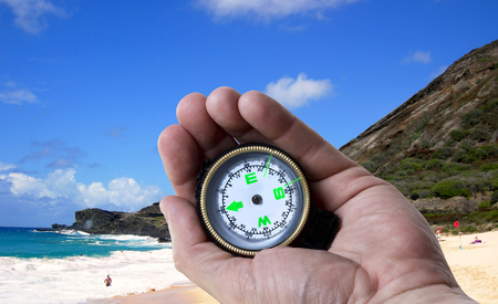 Navigating in Hawaii with a compass in hand.