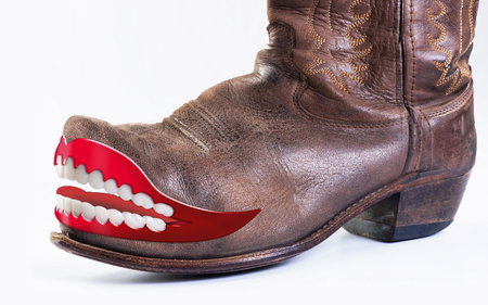 Crazy cowboy boots with grinning teeth. Stock Photo